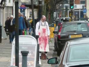 Tim waiting for his lift home..no passerby is worried by the bloodstained axeman@